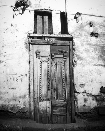 Grayscale photo of closed door