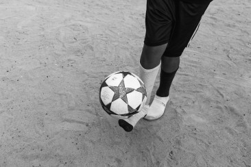 Grayscale photography of person playing ball