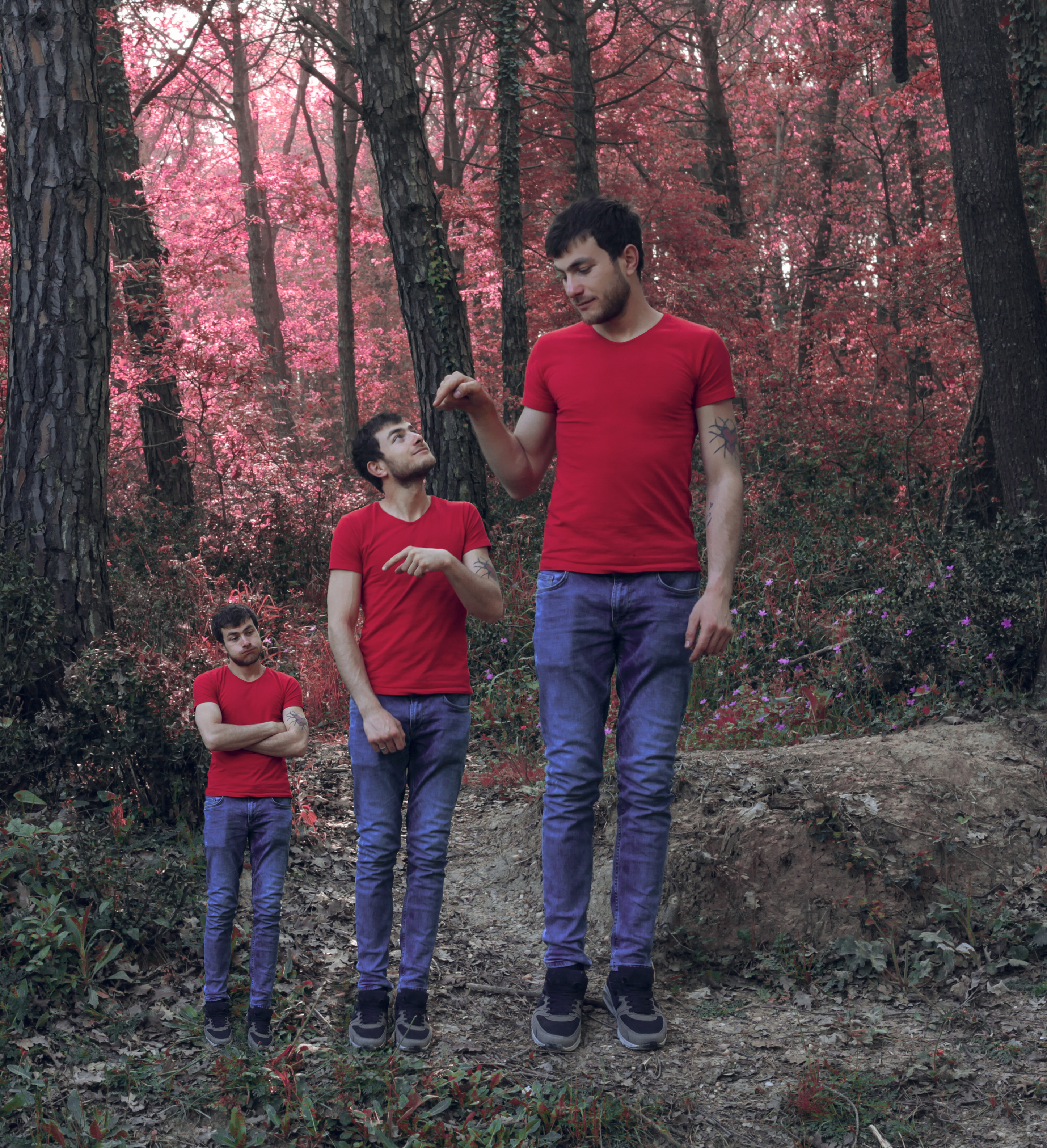 Three men in red t-shirts and blue jeans